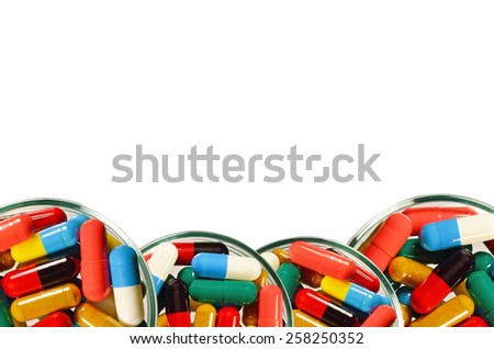 Colorful of oral medications Dish Isolated with Clopping Path. - stock photo