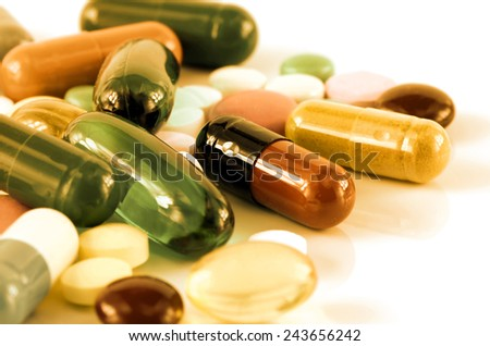 Colorful of oral medications on White Background. - stock photo