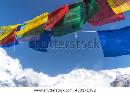 colorful of pray flag in blue sky with annapurna mountain background