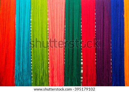 colorful of raw multicolored silk thread background