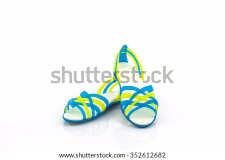 Colorful of Sandals shoes / flip flops on white background. - stock photo