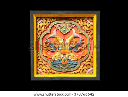 Colorful of wood carving traditional Bhutan style on black background
