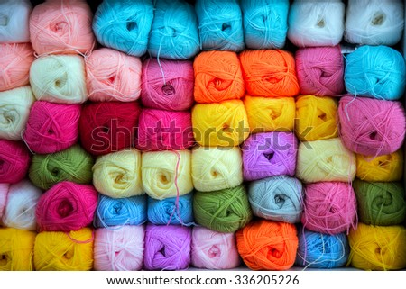 Colorful of Yarn Balls Wool in a Fabric Shop - stock photo