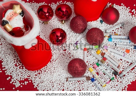 Colorful oil crayon with christmas decorations - stock photo