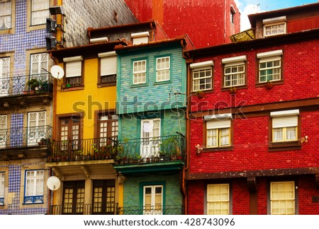 colorful old houses facade in old town, Ribeira embankment, Porto, Portugal, retro toned - stock photo