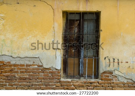 Colorful old window and wall. - stock photo