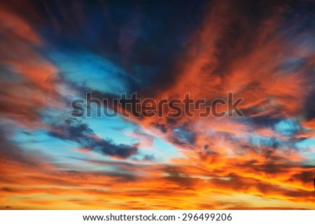 Colorful orange and blue dramatic sky with clouds for abstract background - stock photo
