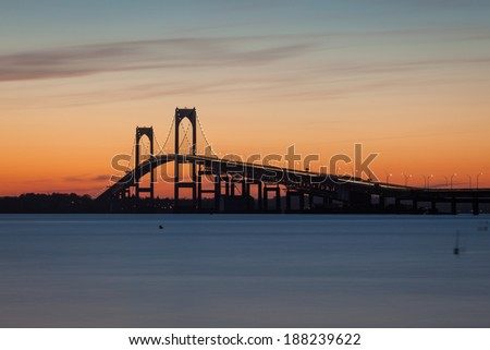 Colorful orange sunset view of the Pell Claiborne bridge between Jamestown and  Newport, Rhode Island, USA. / Newport Bridge Sunset Rhode Island - stock photo
