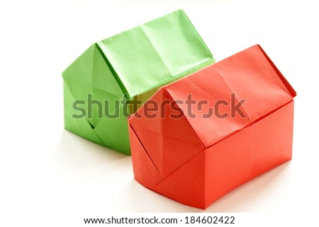 colorful origami paper houses on a white background - stock photo