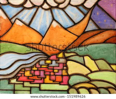Colorful original oil painting of a village and mountains - stock photo