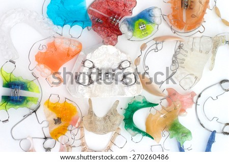 Colorful orthodontic appliances - stock photo
