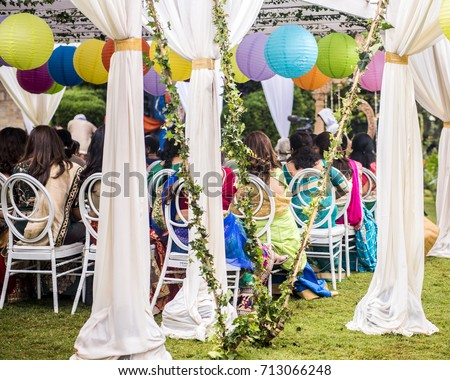 Colorful outdoor lawn tent and garden setting for Indian pre-wedding ceremony. White silk & Colorful Outdoor Lawn Tent Garden Setting Stock Photo 713066248 ...