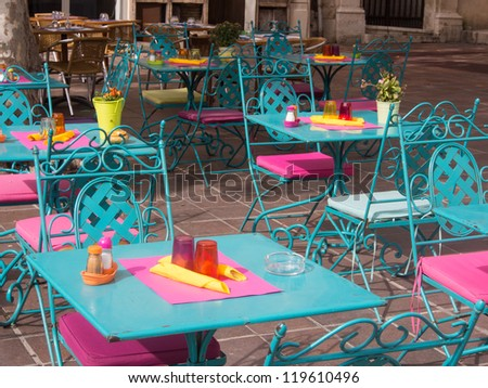 Colorful outdoor table on a road side in France. - stock photo