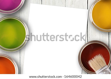 colorful paint cans and blank white paper sheet - stock photo