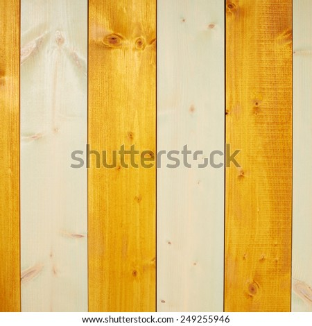 Colorful paint coated pine wood boards fragment as a background composition - stock photo