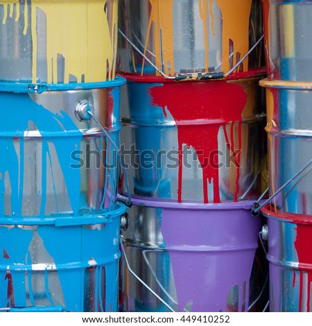 Colorful paint in cans for creativity and work