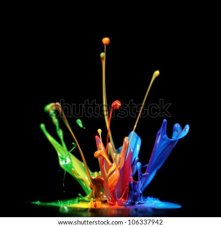 Colorful paint splashing - stock photo