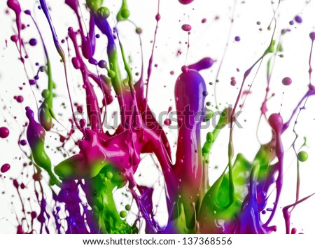 Colorful paint splashing isolated on white - stock photo