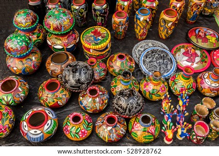 Colorful painted clay vases, pots and various decorative items for sale at a street market in India