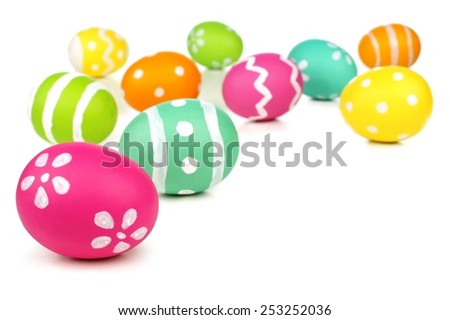 Colorful painted Easter egg border or background over white - stock photo