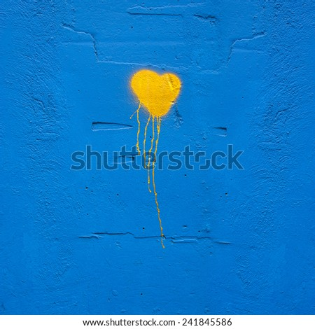 colorful painted hearts on a brick wall - stock photo