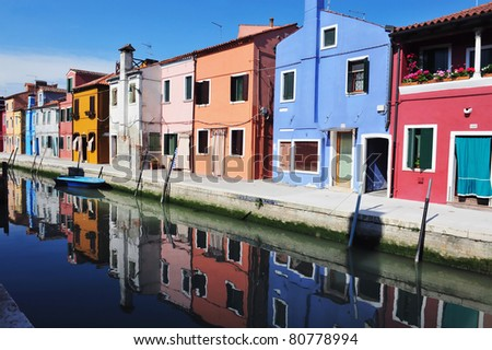 Colorful painted houses on Burano island in the Venetian Lagoon, near Venice in northern Italy.