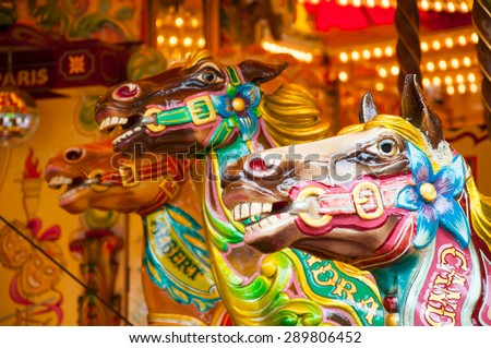 colorful painted ponies on a merry-go-round