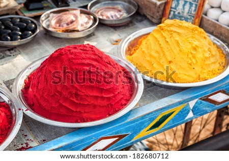 Colorful painting powders and souvenirs at Hampi bazaar - stock photo