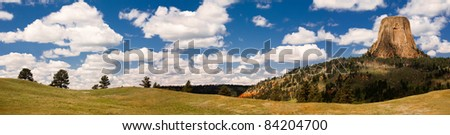 Colorful panoramic image of Devils Tower National Monument in Wyoming - stock photo