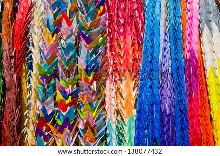 Colorful paper birds hanging on the wall of temple in Japan - stock photo