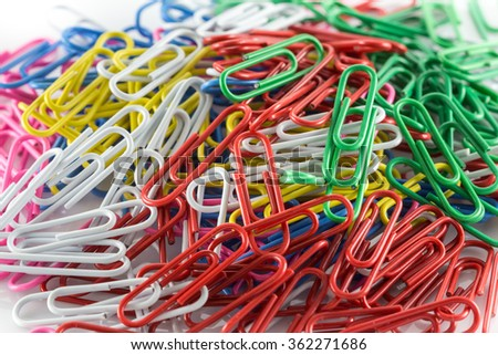 Colorful paper clip isolated on white background - stock photo