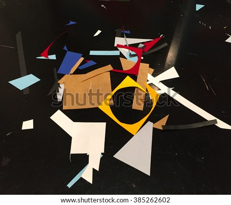Colorful paper cut out, multicolor paper cuts, colorful paper on black background, paper craft hobby, cutting out of paper, crafting hobby, handmade from paper, papier mache, abstract composition - stock photo