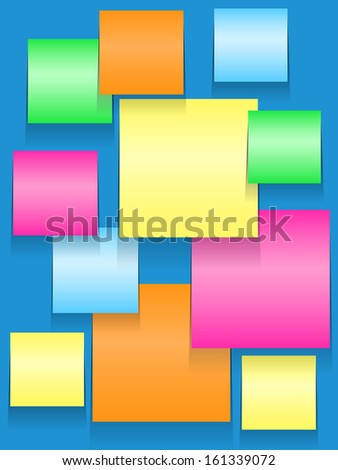 Colorful paper squares, yellow, blue, orange, pink, green, or stickies on blue bulletin board