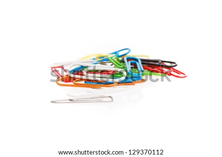 colorful paperclips on white - stock photo