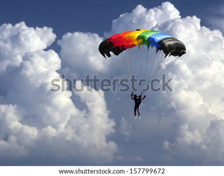 colorful parachute landing as storm is coming.