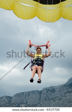 Colorful paraglide on blue sky
