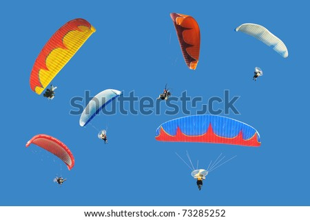 Colorful paramotor on blue sky - stock photo