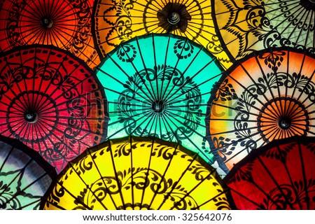 Colorful parasols on display at traditional street market in Bagan, Mandalay Region, Myanmar (Burma).  - stock photo