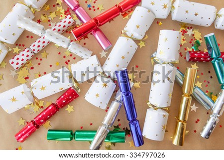 Colorful Party cracker and glittery golden confetti - stock photo