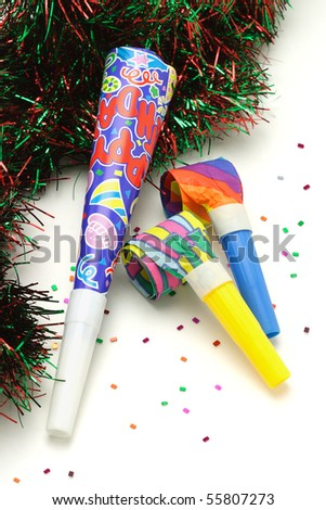 Colorful Party horn and blowers on white background - stock photo