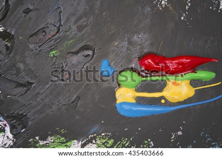 Colorful paste and black background painting - stock photo