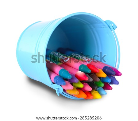 Colorful pastel crayons in holder isolated on white - stock photo