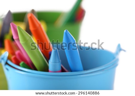 Colorful pastel crayons in holders, closeup - stock photo