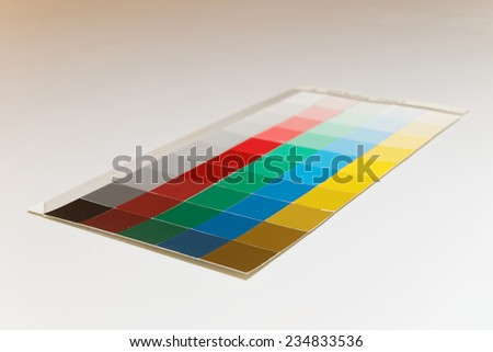 Colorful patches of different shades of  yellow, blue, green, red and gray - stock photo
