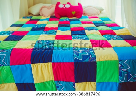 Colorful patchwork quilt on the bed