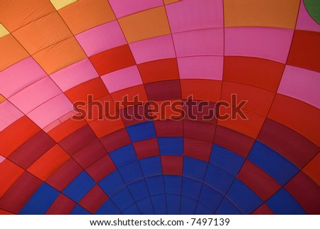 Colorful pattern as seen from the inside of a hot air balloon while being inflated. - stock photo