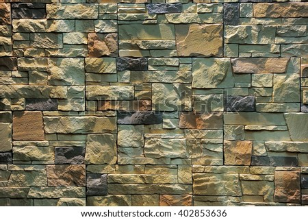 Colorful pattern of decorative brown grey slate stone wall surface