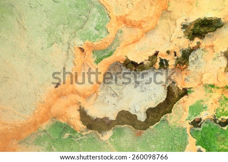 Colorful pattern of minerals deposited by thermal water, Karlovy Vary, Czech Republic - stock photo