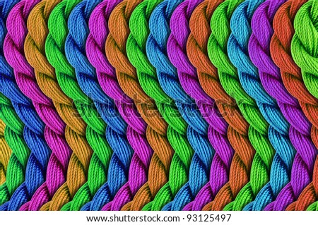 Colorful patterns made of embroidery threads - stock photo