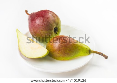 colorful pears and slices in the dish on a white background